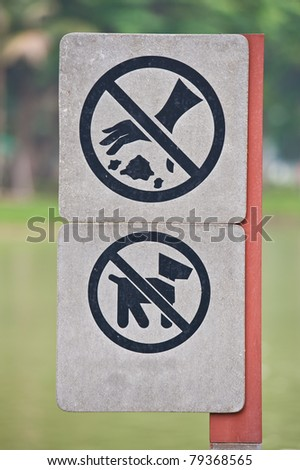No dogs allowed and No littering sign at park - stock photo
