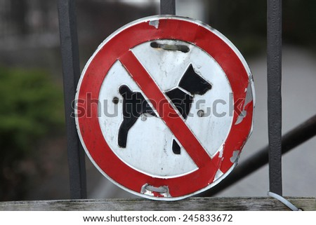 No Dogs Allowed! Old prohibition sign on the entrance gate in Berlin, Germany.  - stock photo