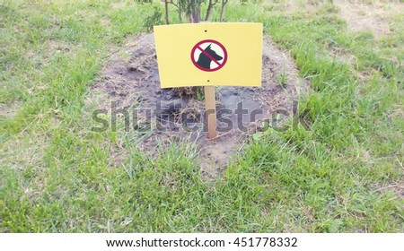 No Dogs Allowed On The Grass Area Sign - stock photo