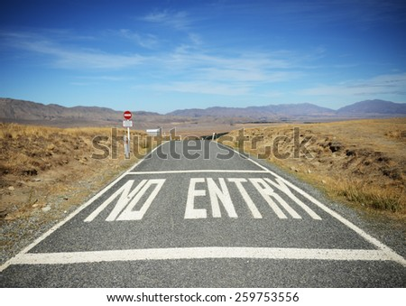 No entry.  A road in New Zealand with huge No Entry letters