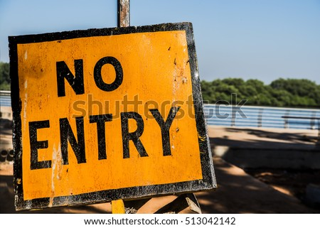 No Entry sign or metal signboard in yellow and black colors. No entry sign, symbol. Yellow traffic sign Caution on the sky background