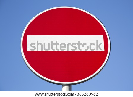 No entry signal isolated on blue sky - stock photo