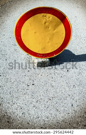 No entry street traffic sign mounted on short poll near ground (grunge effect) - stock photo