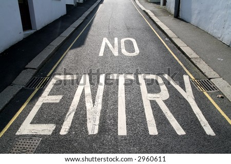 No entry, written on a one way road.