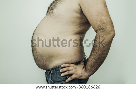 no face. unrecognizable person. Big stomach on a fat man isolated over white or gray background - stock photo