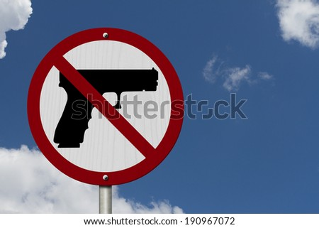 No Firearms Allowed Sign, An red road sign with handgun icon and not symbol with blue sky background - stock photo