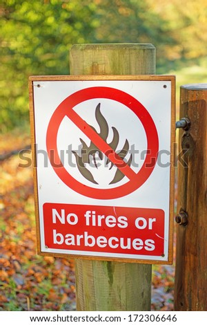 No Fires or Barbecues site in woodland forest  - stock photo