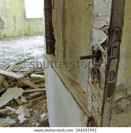 No handle in empty abandoned room - stock photo