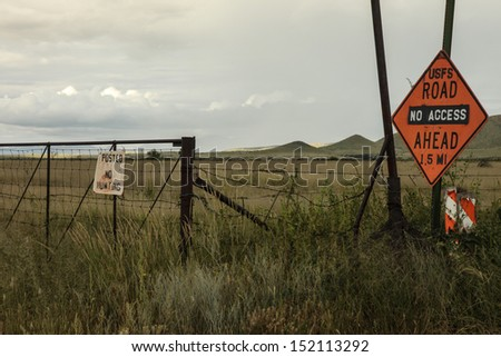 No Hunting and No Access signs along part of Chiricahua foothills of Coronado National Forest in southeastern Arizona, USA/ Do not Enter this Grassland or Road/Summer  green grassland in Arizona - stock photo