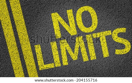No Limits written on the road - stock photo