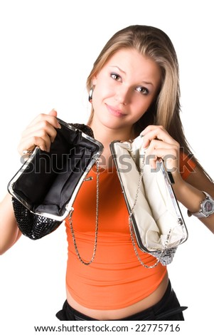 No money in purses. Young woman isolated on white. - stock photo