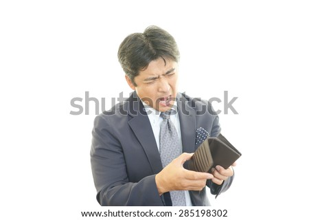 No money left in empty wallet for sad, disappointed young man. - stock photo