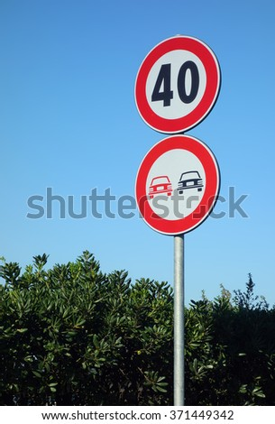 No Overtaking and Speed Limit Road Signs over clear blue sky. Speed limit 40 kmh - stock photo