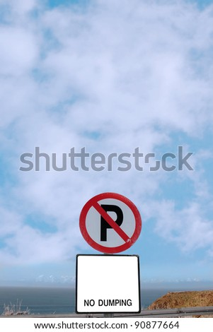 no parking and no dumping sign on a cliff edge in ballybunion ireland - stock photo