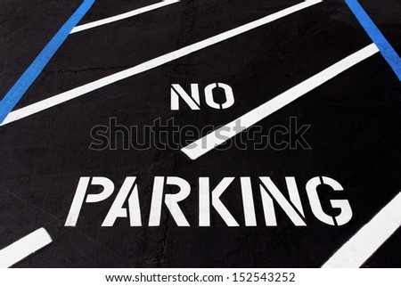 No Parking Painted on Parking Lot for Handicapped - stock photo