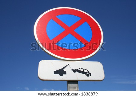 No parking sign tow away zone - stock photo
