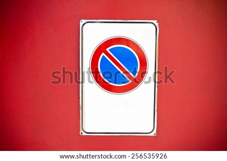 No parking warning sign on red background - stock photo