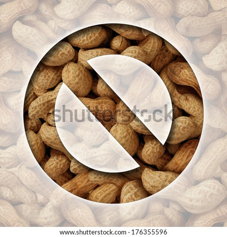No peanuts and a ban on peanut or nut ingredients for allergy reasons as a food prohibition concept with the natural snack behind a ban icon as a safety symbol of avoiding allergic reaction. - stock photo