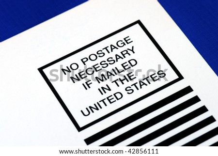 No postage is necessary to mail in the U.S. isolated on blue - stock photo