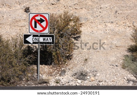 No Right Turn and One Way Sign in the Desert