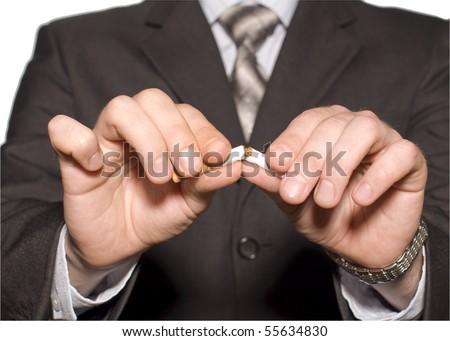 No smoking. A hand crushing cigarettes - stock photo