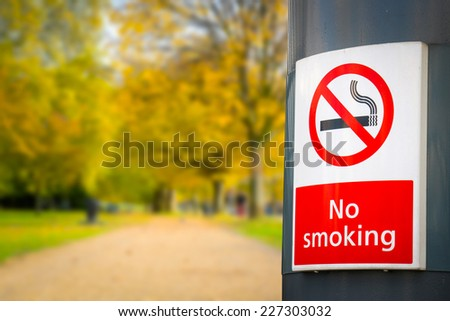 no smoking board & sign in the park