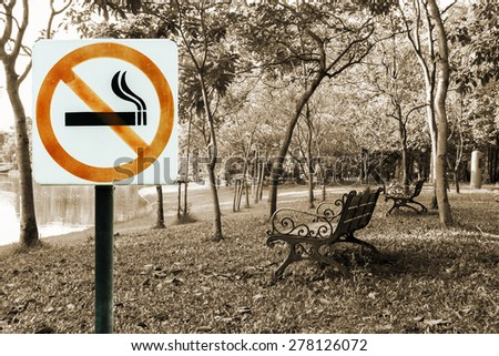 no smoking metal sign in the park, in sepia toned. - stock photo
