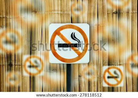 no smoking metal sign on abstract bamboo background. - stock photo