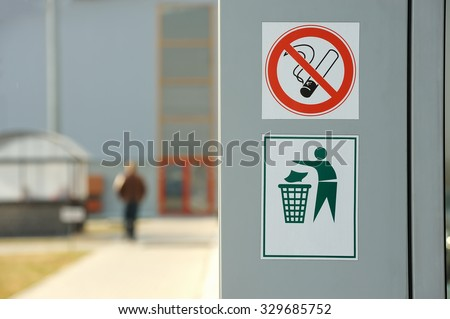 No smoking sign, do not litter sign on the wall - stock photo