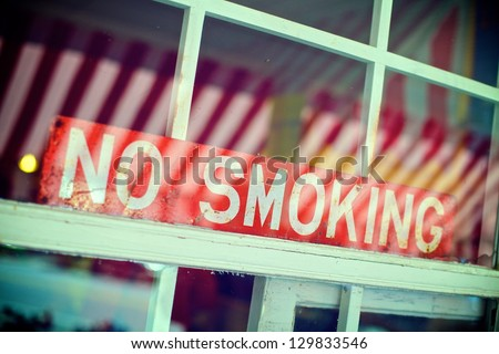 No Smoking Sign in the Window of a Restaurant - stock photo