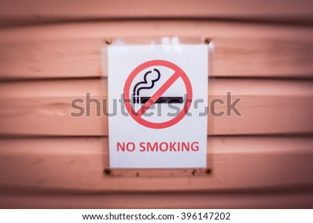 No smoking sign on a wall of a cafe - stock photo