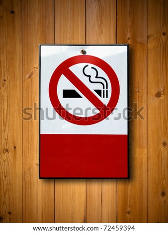No smoking sign on Old wood wall background - stock photo