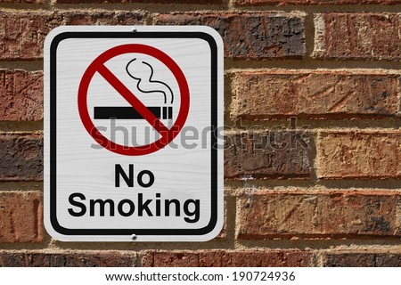 No Smoking Sign, Red and White sign with words No Smoking and cigarette symbol on a brick wall - stock photo