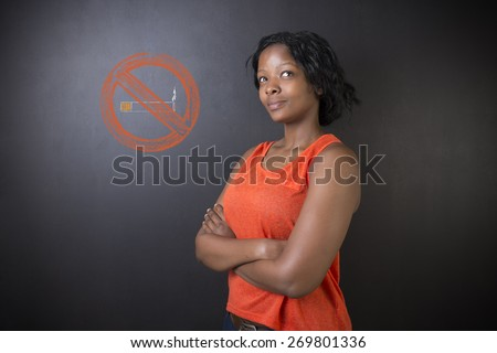 No smoking tobacco addict South African or African American woman teacher or student on blackboard background - stock photo