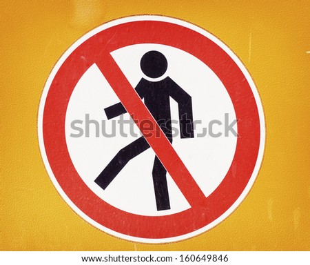 no trespassing sign at a security barrier - stock photo