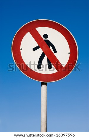 No Walking Sign against blue sky