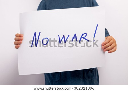 No war text written on paper held by a child - stock photo