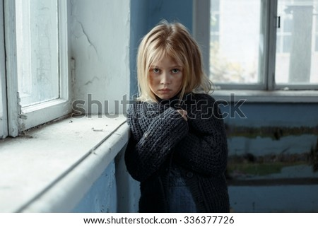 No way out. Ill fated  poor depressed girl folding her hands and standing her window while feeling sad - stock photo