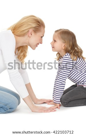 No words needed. Portrait of mother and daughter standing on their knees looking to each other eyes smiling isolated on white. - stock photo