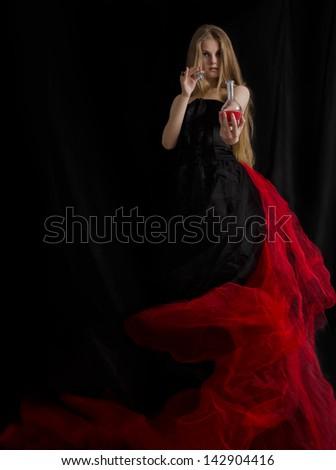 Nobility girl offers a potion.Fine art portrait. - stock photo