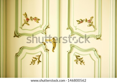 Noble castle door with floral ornaments