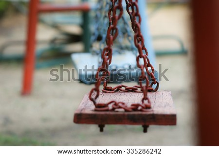 nobody sit on swing in playground - stock photo
