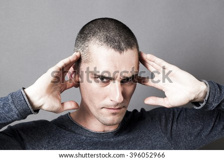 noise and hearing concept - evil-looking young man plugging his ears to avoid listening to problems, contrast effects