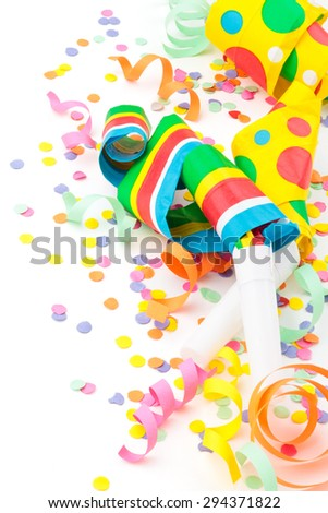 Noisemakers, streamers and confetti. Isolated on white background. - stock photo