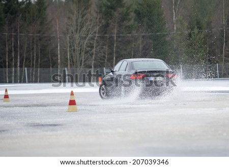 NOKIA, FINLAND - NOVEMBER 2, 2014: The Audi Quattro Tour 2014 test drive day in Nokia, Finland. Professional drivers were teaching how to drive safely in winter conditions on November 2, 2014. - stock photo