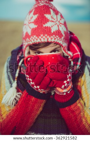 Nomad woman drinking hot beverages outdoor. Lifestyle concept. - stock photo