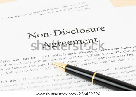 Non disclosure agreement document with pen