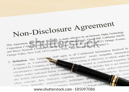 Non disclosure agreement document with pen close-up - stock photo