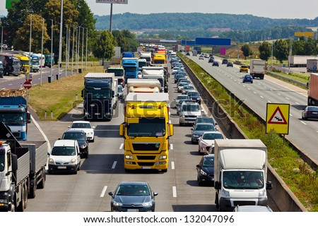 non-functioning emergency lane in a traffic jam on a highway - stock photo