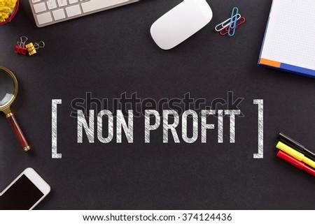 NON PROFIT CONCEPT ON BLACKBOARD - stock photo